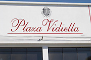 Outside the winery with a name painted in red on a white wall. Bodega Plaza Vidiella Winery, Las Brujas, Canelones, Uruguay, South America
