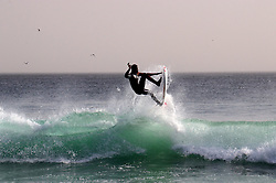DAKAR, SENEGAL - MARCH 11: A man goes surfing at a shore in Dakar, Senegal at The Atlantic Ocean on March 11, 2019. Shores in Dakar draw attention of surfers in all ages but due to the lack of recognition considered as isolated zones. Alaattin Dogru  (Credit Image: RealTime Images)