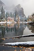 Autumn snow storm along the Merced River in Yosemite National Park, California