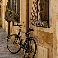 Bicycle on street in Otygia, Italy.