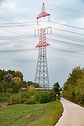 Red and white Electric pylon conducting electric power from the hydroelectric plant, Austria