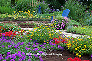 63821-21905 Flower garden with blue Adirondack chair and blue birdhouse.  Butterfly Bushes, Peach, Red  & Purple Verbenas, Yellow & New Gold Lantana (Lantana camara), Raspberry Blast petunias & Diamond Frost Euphorbia in blue pot,  Karl Forster grass, sedums, Marion Co., IL
