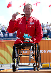 England's Joseph Townsend celebrates winning gold in the Men's Para-triathlon Final at the Southport Broadwater Parklands during day three of the 2018 Commonwealth Games in the Gold Coast, Australia.