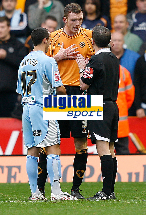 Photo: Steve Bond.<br />Wolverhampton Wanderers v Coventry City. Coca Cola Championship. 06/10/2007. Ref keith Stroud speaks to Neill Collins (C) and Michael Mifsud (L)