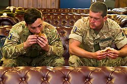 Pictured: Fusilers Louise Gibb and Michael Wardrope enjoy a welcome bacon buttie<br /> <br /> 2 SCOTS arriving home from Iraq deployment. OP Shader troops from The Royal Highland Fusiliers, 2nd Battalion The Royal Regiment of Scotland have been training local forces since December 2017. The troops have been training the local Iraqi forces for the last six months<br /> <br /> <br /> Ger Harley | EEm 19 June 2018