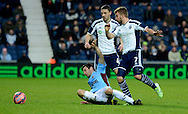 James Morrison is tackled during the The FA Cup match between West Bromwich Albion and Gateshead at The Hawthorns, West Bromwich, England on 3 January 2015. Photo by Alan Franklin.