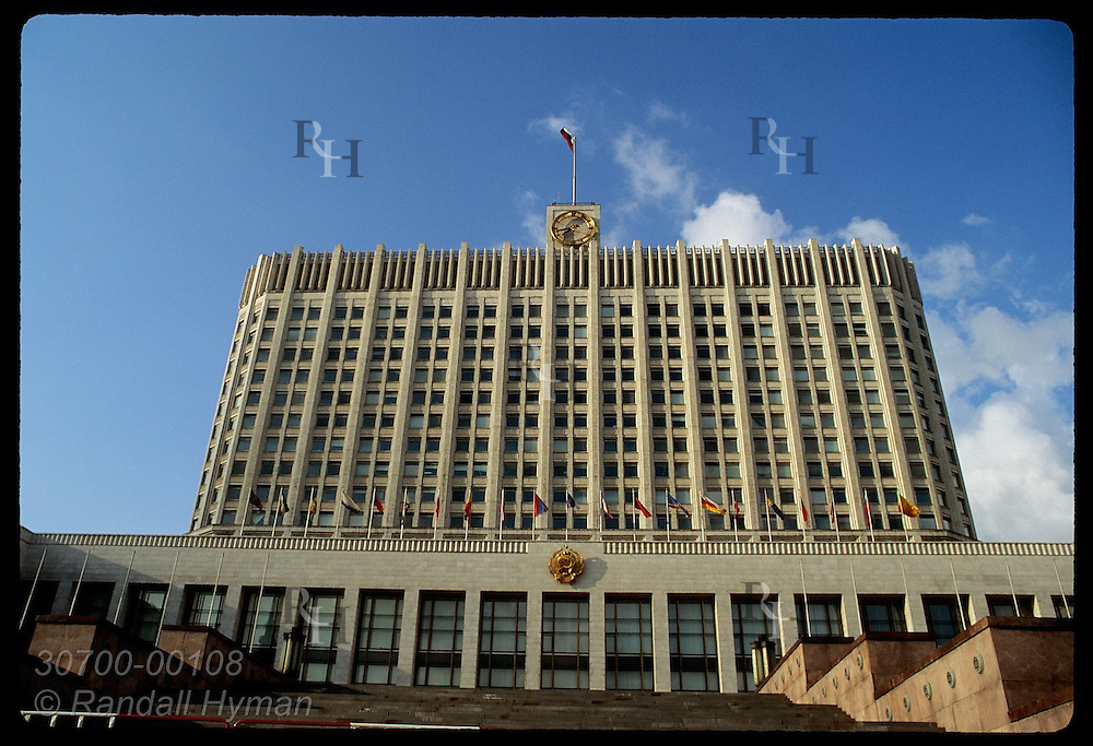The Russian White House, or parliament building, towers against a blue summer sky in Moscow. Russia