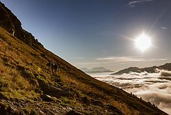THEMENBILD - Wanderer gehen in der Morgensonne auf einem schmalen Weg einen Bergrücken entlang. Eine dicke Wolkendecke liegt über dem Tal, am 16. September 2018 in Saalbach Hinterglemm, Österreich // Hikers walk in the morning sun along a narrow path along a ridge. A thick cloud cover lies above the Hinterglemm valley, Saalbach Hinterglemm, Austria on 2018/09/16. EXPA Pictures © 2018, PhotoCredit: EXPA/ Stefanie Oberhauser