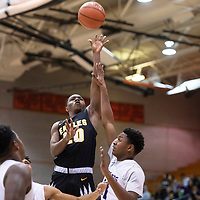 Quintrel Van Hook (20) drives to the basket for Hobbs at the 75th Annual Gallup Boys Invitational Basketball Tournament Championship game against Clovis, Saturday, Jan. 5, 2019 at Gallup High School.