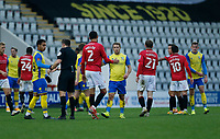 Football - 2020 / 2021 Emirates FA Cup - Second Round: Morecambe vs. Solihull Moors<br /> <br /> Morecambe players commisserate with the players of Solihull Moors after the home team ran out 4-2 winners after extra time, at the Mazuma Stadium.<br /> <br /> COLORSPORT/ALAN MARTIN