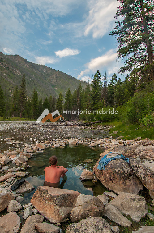 Enjoying sunrise at Sheepeater Camp hot spring, Middle Fork of the Salmon River, Idaho.