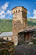 Stone medieval Svaneti tower houses of  Ushguli, Upper Svaneti, Samegrelo-Zemo Svaneti, Mestia, Georgia. Ushguli is a group of four remote villages. At 2,200 m (7217 ft) above sea level in the Caucasus mountains these are the highest inhabited villages in Europe. Chazhashi has 13 well preserved stone Svanetian defensive tower houses attached to stone family houses. A UNESCO World Heritage Site. .<br /> <br /> Visit our REPUBLIC of GEORGIA HISTORIC PLACES PHOTO COLLECTIONS for more photos to browse, download or buy as wall art prints https://funkystock.photoshelter.com/gallery-collection/Pictures-Images-of-Georgia-Country-Historic-Landmark-Places-Museum-Antiquities/C0000c1oD9eVkh9c
