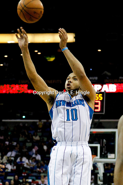 April 13, 2012; New Orleans, LA, USA; New Orleans Hornets shooting guard Eric Gordon (10) shoots against the Utah Jazz during the second half of a game at the New Orleans Arena. The Hornets defeated the Jazz 95-86.  Mandatory Credit: Derick E. Hingle-US PRESSWIRE