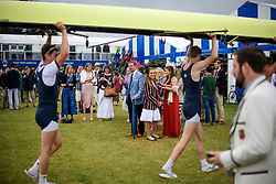 © Licensed to London News Pictures. 28/06/2017. London, UK. Spectators watch a boat being carried form the water on day one of the Henley Royal Regatta, set on the River Thames by the town of Henley-on-Thames in England.  Established in 1839, the five day international rowing event, raced over a course of 2,112 meters (1 mile 550 yards), is considered an important part of the English social season. Photo credit: Ben Cawthra/LNP