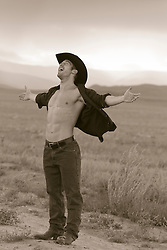 Cowboy enjoying being outdoors with an open shirt