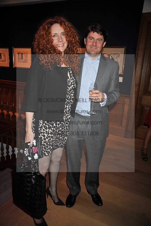 CHARLIE BROOKS and REBEKAH WADE at fundraising dinner and auction in aid of Liver Good Life a charity for people with Hepatitis held at Christies, King Street, London on 16th September 2009.