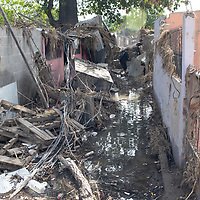 The ruins of housing in Chamelecón, San Pedro Sula, Honduras<br /> <br /> Hurricanes Eta and Iota hit hard on the north coast of Honduras, leaving some areas flooded for three weeks, destroying people's furniture, belongings, vehicles and houses as well as standing crops.