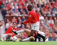 Andy Cole (Man Utd) challenged by Chris Makin (Sunderland). Manchester United v Sunderland. FA Premiership, 9/9/00. Credit Colorsport / Nick Kidd.
