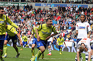Birmingham City's Paul Caddis © celebrates after scoring the equaliser which saved his side from relegation. Skybet football league championship match , Bolton Wanderers v Birmingham city at the Reebok stadium in Bolton on Saturday 3rd May 2014.<br /> pic by David Richards, Andrew Orchard sports photography.