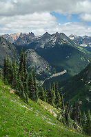North Cascades seen from Summit of Maple Pass, North Cascades Highway State Route 20 is visible below in the Valley, Washington