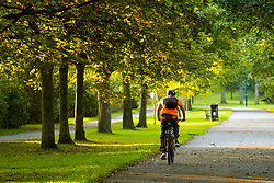 ©Licensed to London News Pictures. 23/09/2019 Aberystwyth UK. UK Weather:  A man cycling down  Plascrug Avenue at daybreak on a bright and sunny Equinox morning, September 23 2019, the first day of official autumn in the northern hemisphere. Today the length of the day and night are roughy equal. Photo credit Keith Morris/LNP