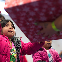 121714      Cayla Nimmo<br /> <br /> Lillian Hannaw receives her gift from a volunteer during the Marine Corps Reserve Toys for Tots event held at the Zuni Wellness Center Wednesday.