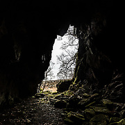 Sloch Cave next to an abandoned township of 9 buildings the cave goes back about 100 feet, gets tighter and lower all the way and ends in a tiny round chamber that just fits 3 people. Ardnish, Scotland.
