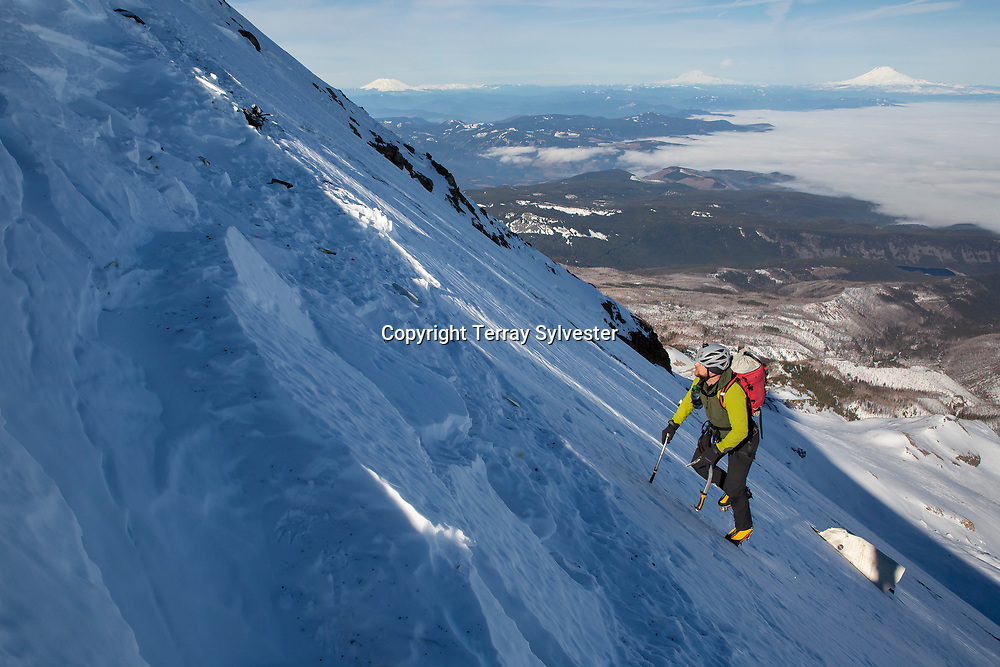 Randy Lee, 45, of Hood River, looks at an impact crater from a plane crash on Thursday, January 31, 2019, while ascending the Cooper Spur on Mount Hood. The pilot, George Regis, 63, died in the crash while reportedly flying from his home in Battleground, Washington, to Arizona.