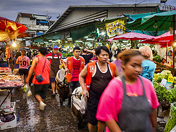 June 8, 2017 - Bangkok, Bangkok, Thailand - Shoppers and workers walk through Khlong Toey Market, Bangkok's main fresh market. Thai consumer confidence dropped for the first time in six months in May following a pair of bombings in Bangkok, low commodity prices paid to farmers and a sharp rise in the value of the Thai Baht versus the US Dollar and the EU Euro. The Baht is surging because of political uncertainty, related to Donald Trump, in the US and Europe. The Baht's rise is being blamed for a drop in Thai exports. This week the Baht has been trading at around 33.90 Baht to $1US, it's highest point in two years. (Credit Image: © Jack Kurtz via ZUMA Wire)