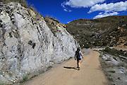 Woman walking in Sierra Alhamilla mountains, near Huebro, Nijar, Almeria, Spain