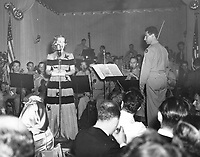Aug. 29, 1942Bette Davis addresses the audience during the Hollywood Canteen fundraiser at Ciro's