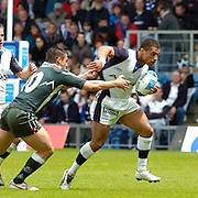 2005 European Challenge Cup Final Sale Sharks v Pau, ENGLAND, 21.05.2005, Jason Robinson, breaks fre from the tackle of Lionel Beauxis.<br /> Photo  Peter Spurrier. <br /> email images@intersport-images