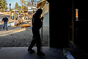 Jerry Wilson (center) at his property as a construction crew builds his new home along Kibler Road on Wednesday, Oct. 23, 2019, in Paradise, Calif. Jerry and his wife Patty Wilson lost their home in the 2018 Camp Fire. They live in a mobile home as they continue to rebuild their home.