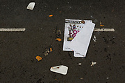 A detail of litter featuring a poster about musician and entertainer, Noah Powa in a London street, on 1st January 2019, in London, England.