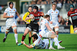 Saracens Full Back (#15) Ben Ransom is tackled by Exeter Chiefs Full Back (#15) Luke Arscott during the first half of the match - Photo mandatory by-line: Rogan Thomson/JMP - Tel: Mobile: 07966 386802 16/02/2013 - SPORT - RUGBY - Allianz Park - Barnet. Saracens v Exeter Chiefs - Aviva Premiership. This is the first Premiership match at Saracens new home ground, Allianz Park, and the first time Premiership Rugby has been played on an artificial turf pitch.
