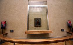 Nov. 30, 2011 - Paris, California, U.S. - Tourists admire the famous Leonardo Da Vinci painting ' The Mona Lisa' in the Grande Galerie of the Louvre museum in Paris, France. (Credit Image: © Ringo Chiu/ZUMAPRESS.com)