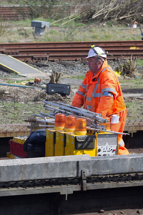 © Licensed to London News Pictures . 14/04/2013 . London , UK . Railway engineers on the track 2 miles north of Euston on the West Coast Mainline as a signalling failure this morning (Sunday 14th April) caused delays of up to an hour for thousands of travelling Manchester City fans heading to the capital to watch their FA Cup tie against Chelsea . Several trains stood stationary for up to an hour . On one train free tea and coffee was offered only for the tea and coffee machine to break down , causing further frustration for passengers . Photo credit : Joel Goodman/LNP