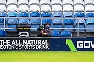 Photographer wearing a facemask, PPE, during the EFL Sky Bet Championship match between Queens Park Rangers and Barnsley at the Kiyan Prince Foundation Stadium, London, England on 20 June 2020.