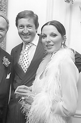 JOAN COLLINS & RON KASS at a party fhosted by Margaret, Duchess of Argyll at her home in Upper Grosvenor Street, London on 20th June 1974