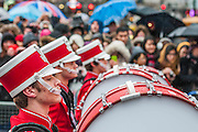 A new year's day parade passes through Piccadilly Circus on a wet and windy day. London, UK 01 Jan 2014. Guy Bell, 07771 786236, guy@gbphotos.com