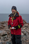Steve Forrest, Conservation Biologist and lead scientist on board, stands for a portrait while counting penguins on a small island next to Two Hammock Island in Antarctica, on February 1st, 2020.