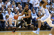 01 December 2015: Maryland's Melo Trimble (2) and North Carolina's Nate Britt (0). The University of North Carolina Tar Heels hosted the University of Maryland Terrapins at the Dean E. Smith Center in Chapel Hill, North Carolina in a 2015-16 NCAA Division I Men's Basketball game. UNC won the game 89-81.