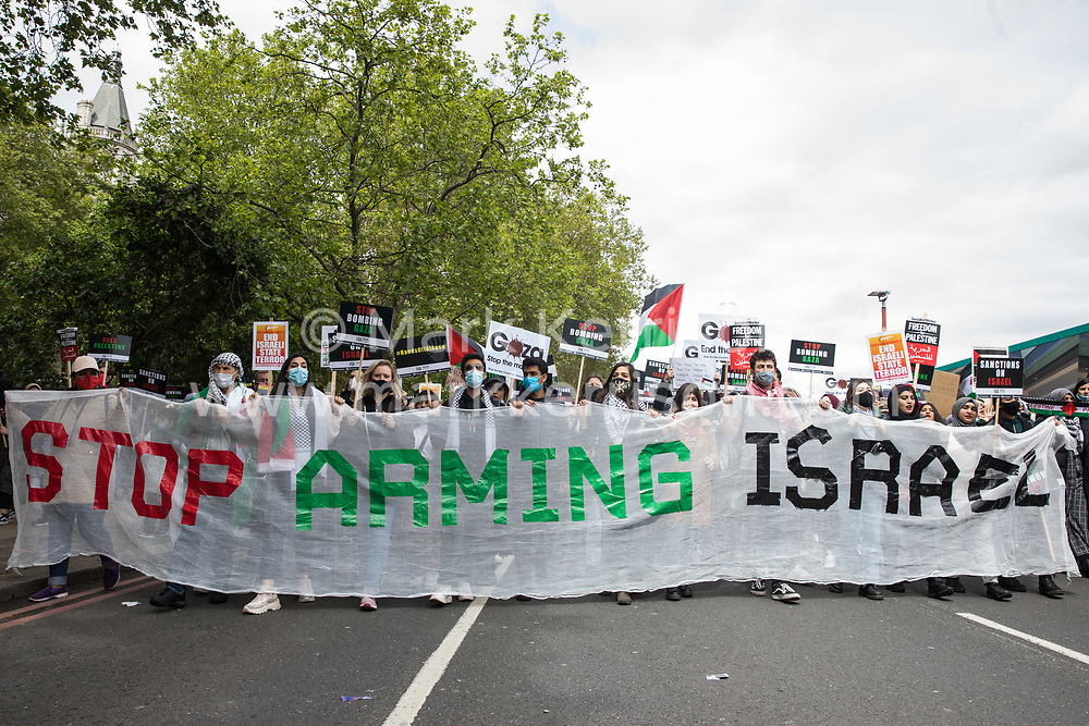 Activists march behind a Stop Arming Israel banner during the National Demonstration for Palestine from Victoria Embankment to Hyde Park on 22nd May 2021 in London, United Kingdom. The demonstration was organised by pro-Palestinian solidarity groups in protest against Israel's recent attacks on Gaza, its incursions at the Al-Aqsa mosque and its attempts to forcibly displace Palestinian families from the Sheikh Jarrah neighbourhood of East Jerusalem.