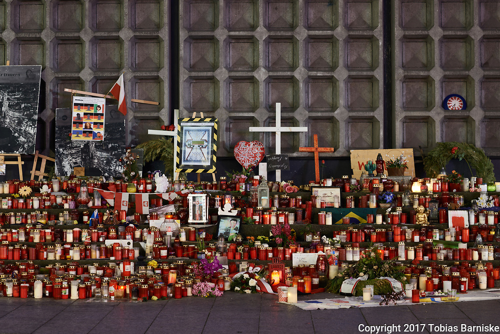 On December 19, 2016, the Islamist assassin Anis Amri killed 12 persons on a Christmas market in Berlin. Amri kidnapped a truck, shot the driver dead and drove the truck into the visitors at the christmas market, nearby the Kaiser Wilhelm Memorial church. 11 visitors died and 56 others were injured. To this day, the residents of Berlin place candles, flowers and others at the place to remember the victims.