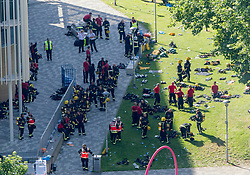 Emergency services gather close to the scene after a fire engulfed the 24-storey Grenfell Tower in west London.