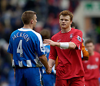 Photo: Jed Wee.<br />Wigan Athletic v Liverpool. The Barclays Premiership. 11/02/2006.<br />Liverpool's John Arne Riise (R) shakes hands with Wigan's Matt Jackson at the end of the match.