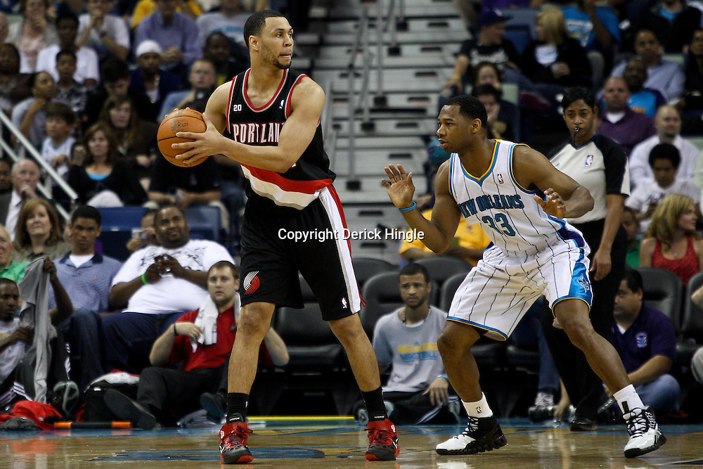 March 30, 2011; New Orleans, LA, USA; Portland Trail Blazers shooting guard Brandon Roy (7) is guarded by New Orleans Hornets shooting guard Willie Green (33) during the first half at the New Orleans Arena.    Mandatory Credit: Derick E. Hingle