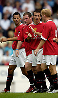 Fotball<br /> Foto: SBI/Digitalsport<br /> NORWAY ONLY<br /> <br /> Clyde v Manchester United, Preseason Friendly. 16/07/2005.<br /> <br /> Manchester United congratulate scorer Liam Miller (2nd from R).