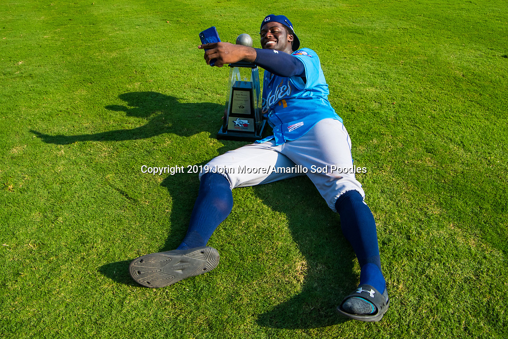 Amarillo Sod Poodles outfielder Taylor Trammell (7) poses with the trophy after the Sod Poodles won against the Tulsa Drillers during the Texas League Championship on Sunday, Sept. 15, 2019, at OneOK Field in Tulsa, Oklahoma. [Photo by John Moore/Amarillo Sod Poodles]