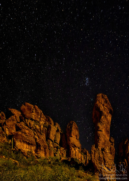 Large rock spires point to the night sky above the Superstition Mountains in the Superstition Wilderness, Arizona.